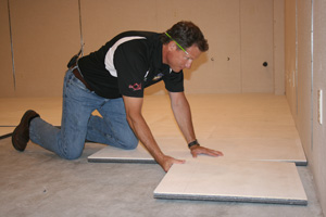 Insulated basement subfloor installation in Lansing