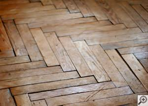 Warped wood floor problems in grand rapids lansing kalamazoo a city buckling wood floor ppazfo